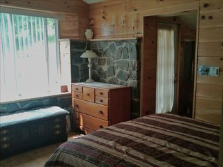 Ithaca cottage photo - Rear bedroom with queen size bed and view of pond