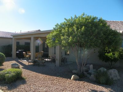 Chandler house rental - Backyard with outdoor seating and dining. Gas BBQ.