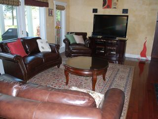 Oconomowoc house photo - The great room has outstanding furniture with brand new leather couches 47in TV