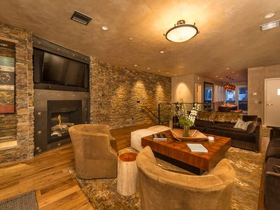 Cozy and comfortable seating in main living area with fireplace and huge views