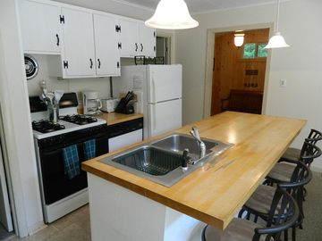 Fully equipped kitchen with breakfast bar with seating for four more people