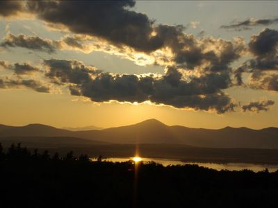 Sunset over lake & mountains