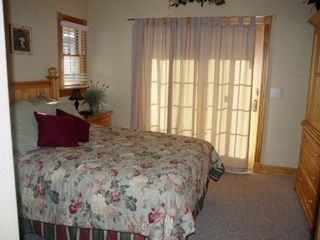 Corolla house photo - One of 2 other Master Suite bedrooms, this one with a private deck