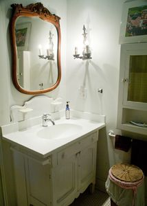Each bedroom has private bathroom . Antique mirror over new bathroom sink