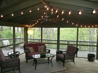 Hedgesville cottage photo - Expansive screened porch and deck