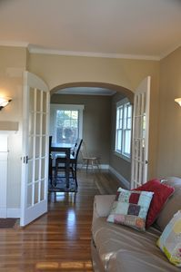 Living room into dinning room with curved french doors