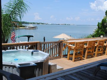 Dauphin Island house rental - View from covered porch overlooking Dauphin Island bridge. Sunsets are awesome!
