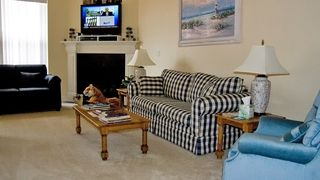 Lincoln City house photo - Living Room with Fire Place, TV & Guard Tiger.
