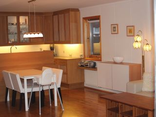 Reykjavik apartment photo - Open kitchen and living room. Table with four chairs and a childseat