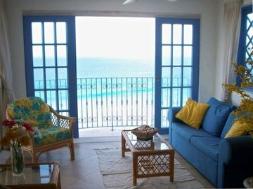 The enclosed solarium with its beautiful ocean views, sounds, and breeze