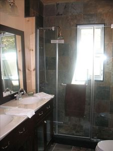 Ensuite Bath with large shower, heated slate floors, double sinks, skylight.