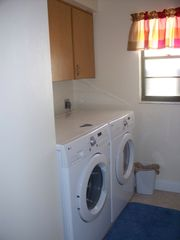 Vanderbilt Beach house photo - hi-efficiency washer and dryer for your use. Detergent and dryer sheets include