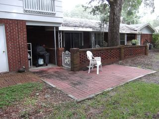 Jekyll Island house photo - Backyard outside patio. Note gas grill stored behind gate.