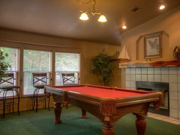 Enjoy a game of pool in lakefront 4-bedrm/2-bath cottage in wooded,private spot