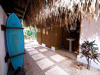 Surfboard storage and separately enclosed shower & toilet.