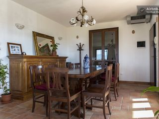 Montopoli Val d'Arno house photo - More than fifteen can sit at dining room table while looking at a stunning view.