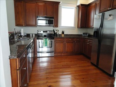 Modern and spacious kitchen - hardwood floors thru out all levels; fully stocked