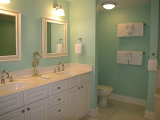 Fort Walton Beach condo photo - Master bath with double sinks, toilet, garden tub, and walk-in-shower.