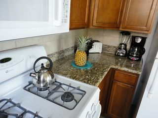 Kihei condo photo - Gas stove, granite counter tops, updated appliances.