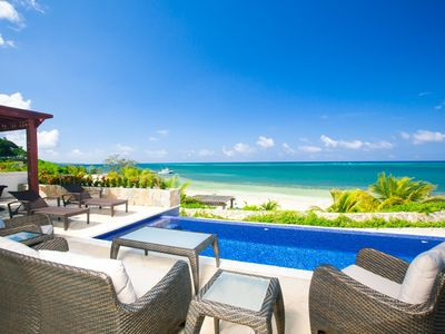 Stunning view of our pool, private beach and the Caribbean from our main patio