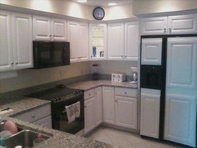 Kitchen has all appliances and is fully stocked. Laundry Room is off Kitchen