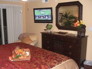 Bel Mare Ocean City condo photo - Master bedroom, flat screen tv, balcony looking towards boardwalk,