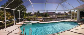Cape Coral villa photo - Heated Pool with Jacuzzi (electric & solar panels) South Facing