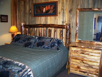 Bedroom with pillow top king bed and log furniture