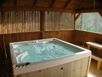Relax in a large HOT TUB in a private covered gazebo overlooking the view