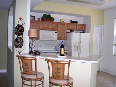 Large, open, bright kitchen off of lanai