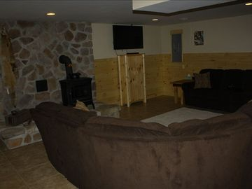 "Lower Level sitting area with sofa seating for twelve with 50"" flat screen"