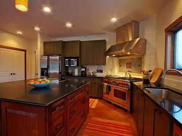 "Spectacular gourmet kitchen has 48"" Wolfe 6 burner gas top range w/2 ovens."