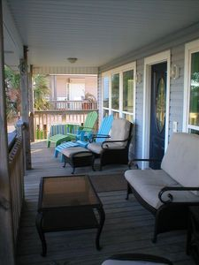 Front deck facing the beach is less than 1500ft away & ample seating for 9+