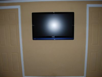 Two flatscreen HD televisions-the one in main room has DVD player