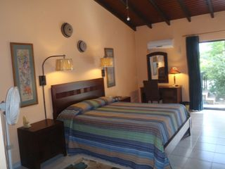 Bonaire house photo - Guestroom with queen bed, private bath and exit to pool & private gardens