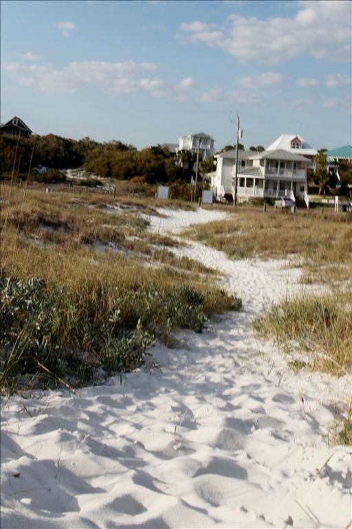 View from dune and beach towards house.