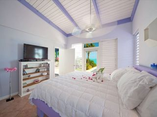 Providenciales - Provo villa photo - ocean views shift to relaxing hues within the king