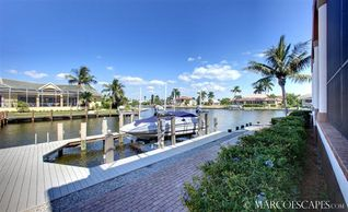 Vacation Homes in Marco Island house photo - Large Dock with Power Lift and Boat Slip ...