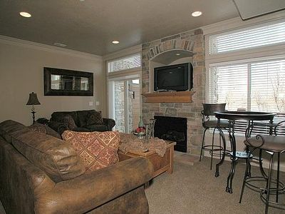 Living room with gas fireplace, flat screen HD TV , Blueray  player and sleeper