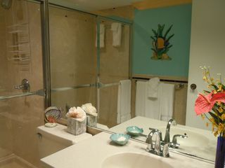 Grand Cayman condo photo - Ensuite master bath has walk in shower