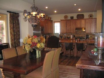 Large dining room table, kitchen.