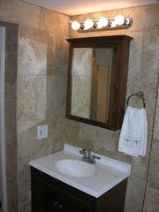 El Centro Beach cottage photo - Travertine Style Tile from floor to ceiling, New