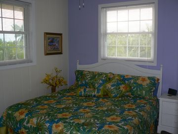 Second master suite- king bed with a private entrance to the bathroom.