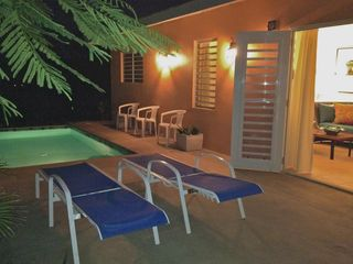 Vieques Island villa photo - The living room french doors open up onto the dipping pools private Verandah