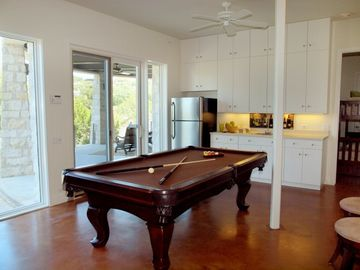 Game Room has Pool Table, Bar, Seating, Access to Patio