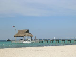 Nearby pier to get you to your water activities. - Cozumel condo vacation rental photo