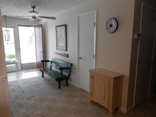 Vermilion house photo - Entry Hall with vintage trolley bench