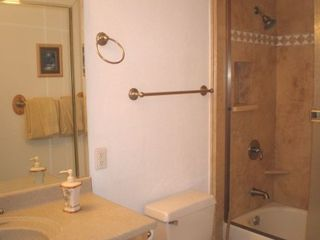 Maalaea condo photo - Bathrooms have custom tile work, maple cabinets and corian countertops