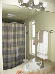 Bath with tub shower combination, linen closet, medicine cabinet & fluffy towels