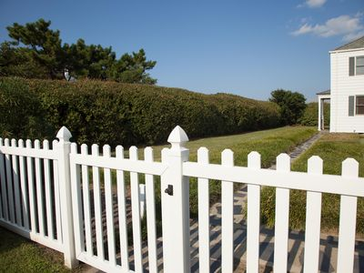 Enter our gated yard through the white picket fence.